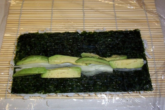 Sushi_inside_out_being_rolled